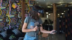 With no way of generating resistive force feedback with today's VR motion controllers,how can we make users feel and behave as…