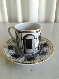 Check out this item in my Etsy shop https://www.etsy.com/listing/615802545/fornasetti-cup-rosenthal-espresso-cup