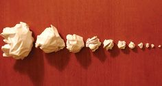 PAPER TOSS When sheets of paper were scrunched, variations in surface area (larger on the left) led to balls with different levels of crumpled folding. Surface area is one part of a new equation that may help describe how brains fold. ~~ Suzana and Luiza Herculano-Houzel