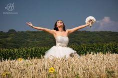 Bride in a hay field in summer
