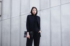 Elisa from the Fashion- and Lifestyleblog www.schwarzersamt.com is wearing a black blazer from COS, neopren pants from ASOS, business shoes from ZARA, a turle neck pullover from funktionschnitt, a black the fifth watches watch and a ASOS clutch. It's a minimal und clean allblack look, perfect for wearing it as a business outfit with a twist.
