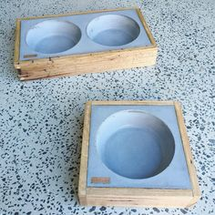 Concrete Dog bowls by Slabshapers - Fully Customisable with colours, copper tag inset with your pets name, and timber surround.