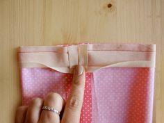 Abrir los márgenes de costura de la cinta al bies
