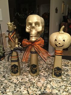 Halloween costume trophies made from vases and Halloween items from Dollar Tree..