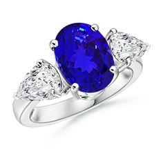 Oval Tanzanite and Pear Diamond Three Stone Ring in Platinum