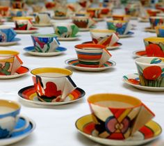 A collection of Art Deco, early 1930s, Clarice Cliff Teacups