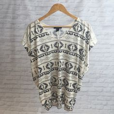 F21 Tribal Top Cute tribal top from forever 21! Festival season is coming up and also it's spring which means it's closer to summer!  it will be super cute to wear! Forever 21 Tops Tees - Short Sleeve