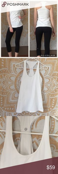 Lululemon Ω Essential White Racerback Tank Top No size tag, I believe this is a 4 as it fits me very well and that's the current lulu size I buy. ⚜️I love receiving offers through the offer button!⚜️ Good condition, as seen in pictures! Fast same or next day shipping! Open to offers but I don't negotiate in the comments so please use the offer button😊 lululemon athletica Tops Tank Tops