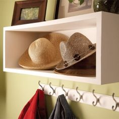 Organize the clutter. These simple, but handsome, box shelves will store books, hats, shoes, and all kinds of knick-knacks.