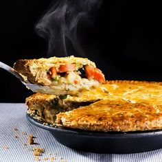 Master chicken potpie with this recipe for creamy chicken and vegetables packed in a flaky crust studded with fresh herbs and garlic.