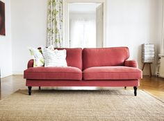Whoa, Nelly! Ikea just launched a bunch of new additions that reach back into a more traditional European past. This roll arm sofa is killer at less than $600 in this soft red fabric, which is slipcovered so that you can wash or replace as needed. I'm seeing it on the site right now in black, grey and cream, but this light red IS coming too.