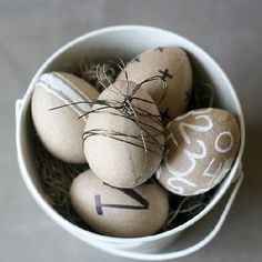 Create a more modern Easter display using paper mache eggs, wire, a Sharpie and Chalk Pen. Easy to do in under 30 minutes!