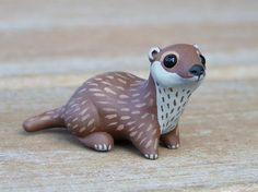 Handmade polymer clay tiny river otter  visit http://stitchme.gifts for more