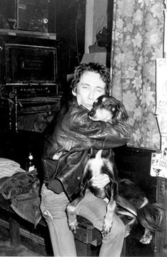 Dead Boys vocalist Stiv Bators with CBGB owner Hilly Kristal's trusty dog Jonathan, 1977.