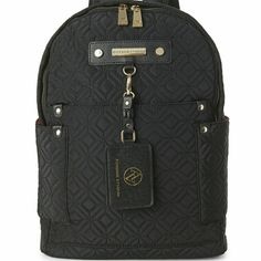 """Adrienne Vittadini Backpack Quilted fabric exterior, faux leather trim,?padded and adjustable shoulder straps, top handle, metal logo plaque, open pockets at front and sides Removable ID tag, gold-tone hardware, fabric interior lining, interior zip pocket, zip closure 12"""" L x 14"""" H x 5"""" W Nylon body Adrienne Vittadini Bags Backpacks"""