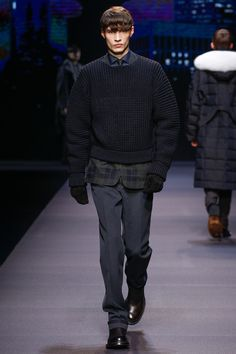 Ermenegildo Zegna | Fall 2014 Menswear Collection | The path from initial idea to the physical actuality of a fashion show has seldom been as extraordinary as it was with today's presentation of the new Ermenegildo Zegna collection for men. When Stefano Pilati was trying to pin down the essence of the label, two words came to him: city (Zegna's traditional suit-iness) and nature (the fibers that have made Zegna the world's most successful producer of fine fabrics).