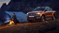 Ford Ranger with headlights and camp fire