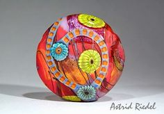 Astrid Riedel Glass Artist: Blown Hollow lentil shaped focal bead partly etched and cold worked.