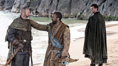 Davos convinces Salladhor Saan to join Stannis, while his son Matthos looks on.