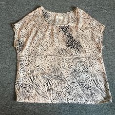 Urban Outfitters animal print shirt Short sleeve. Body cut. Silky fabric. Urban Outfitters Tops Tees - Short Sleeve