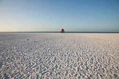 At first glance, Siesta Beach, on Florida's Gulf Coast, looks like the standard picture-perfect shore. It has clear blue water, exceptionally white sand, and is so pristine that Dr. Leatherman rated it the number one beach in America. But once you kick off your flip-flops, your feet will experience what makes this beach so unique. The powdery sand is 99.9 percent quartz crystal and so fine and uniform in size that it squeaks when you walk on it. Plus, its composition allows it to stay cool even with the hot summer sun blazing down.