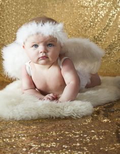 Angel wings 6 month old family photos, gold glam sequin background. M.Reed Studio.