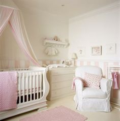 I absolutely adore this pink nursery! Such beautiful striped wainscoting!