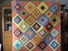 Layer Cake Stars Quilt.  I like patterns that use the pre-cut fabrics.  This is one beautiful quilt.