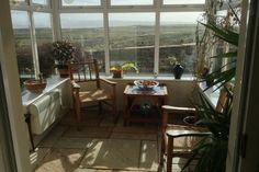 """The sunroom which links to the kitchen. A ray of sunshine brings in so much heat. Lovely for breakfast """"outside"""" but inside ; County Clare, Sunroom, Ireland, The Outsiders, Surfing, Sunshine, Farmhouse, Cottage, Houses"""