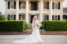 Take your bridals in front of a beautiful plantation home for a unique and classic venue. The sheer veil and lace dress with the white bouquet make a beautiful classy photo even more perfect.