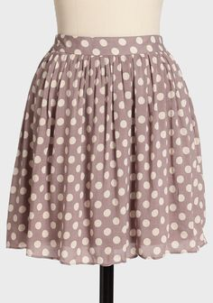 "Coffee Date Polka Dot Skirt 36.99 at shopruche.com. Delicate and breezy, this dusty mauve skirt is adorned with a cream polka dot print, gathers at the waist for added fullness, and an elasticized smocked waist for a flattering and comfortable fit. Fully lined. Style with a peplum top and flats for a chic vintage-inspired look.100% Rayon, Imported, 17.5"" length from top of waist"