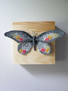 Fabric sculpture -Dark gray butterfly textile art by YumiOkita on Etsy https://www.etsy.com/listing/162918123/fabric-sculpture-dark-gray-butterfly
