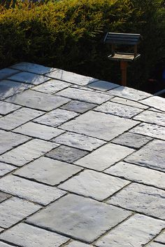 Front patio can make this with 3 sizes of concrete pavers and maybe stain it.