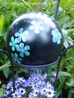 I almost like this simple idea better!  Maybe use Cricut to cut Vinyl and then Mod Podge or seal it with something!  @Sue Krassow  From Bowling Balls to Garden Art