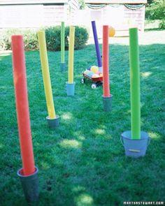 Obstacle Course: Red Wagon Slalom - Stand colorful foam pool noodles in gallon buckets weighted with sand and set up a zig zag pattern. Fill a wagon with small water balloons. Kids must pull the wagon around the outside of each bucket without spilling any balloons.