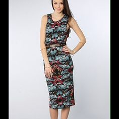 """✳️30%off TDay Free People Midi Dress BRAND NEW A classically chic Free People dress comes to life with an allover tropical print and slinky, stretchy form-fitting silhouette. Extremely lightweight and cool. Crewneck and sleeveless. Approx 3"""" above ankle.""""  Rayon/spandex : feels like jersey knit. NWT. Do not purchase this listing, I'll make u a new one. Offers welcome. Free People Dresses Midi"""