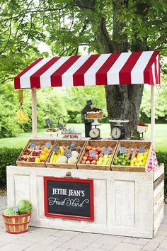 Fruit Stand for kids or for farmers market!  I love the recycled door and pallet wood!    @Claire Beast Farm Stand Inspiration!