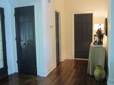 Bellissimo and Bella: Making An Entrance The door color is Wrought Iron by Benjamin Moore. All of the walls and trim are Mascarpone by BM too.