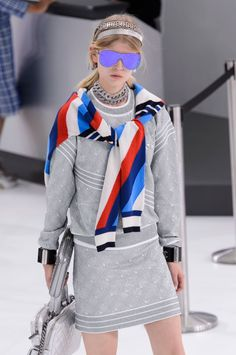 The 9 Coolest Things About Chanels Airport Themed Spring Show - Silver headbands and oversize mirrored aviators were two major accessory looks on the Chanel runway.
