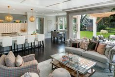 Open Kitchen Design. Kitchen opens to breakfast room and family room with folding patio doors. Open feel interiors. Spacecrafting Photography. City Homes Design and Build, LLC. Jodi Mellin Interiors.