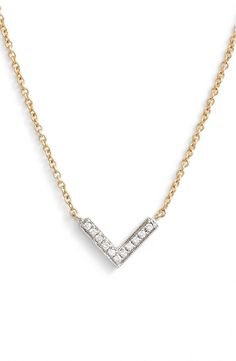 Crushing on this gorgeous pendant with a dainty geometric V that is detailed in radiant diamonds. An elegant 14-karat gold chain even makes this two-toned piece easy to layer.