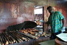 Making jerk chicken at the famous Scotchies restaurant in Jamaica