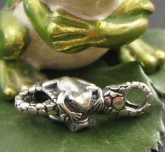 The frog as spirit animal or totem reminds us of the transient nature of our lives. As symbol of transition and transformation, this spirit animal supports us in times of change. This lock features an agile frog on both sides. Lovingly carved in wax then cast in solid sterling silver.