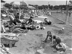 Possible Flashback.      The swimming area at Indiana beach on Lake Shafer near Monticello was packed with people as temperatures and humidity reached uncomfortable levels on Aug. 4, 1983. At right, Tim and Denise Bertagnolli played in the sand after a cooling dip in the water. Indianapolis News Photo / Gary Moore