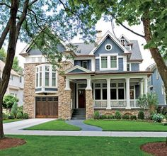 Edwardian Suburban Style, Traditional Home, cottage feel, front porch, distinctive bay window, wood garage door, blue house,  White kitchen, marble backsplash, microwave built in columns.