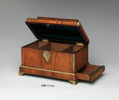Abraham Roentgen (German, 1711–1793)  Date:     ca. 1750–55 Culture:     German, Neuwied am Rhein Medium:     Oak, cedar, veneered with rosewood; brass, iron, and steel Dimensions:     Overall (without handle): H. 6 1/2 x W. 9 1/2 x D. 5 3/4in. (16.5 x 24.1 x 14.6cm)