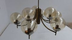 1950's Italian glass & brass chandelier with 9 glass globes | From a unique collection of antique and modern chandeliers and pendants  at https://www.1stdibs.com/furniture/lighting/chandeliers-pendant-lights/