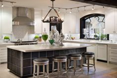 Joy Tribout Interior Design Modern contempory kitchen design. Fabulous island, chairs and window ideas