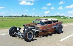 insane rat rod '57 Chevy roadster.