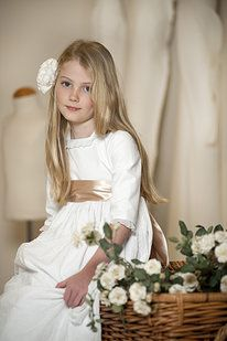 www.teresaleticia.com  Found where you can order these first communion dresses for $99 - but I don't know what currency that 99 is in.